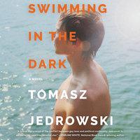 Swimming in the Dark: A Novel - Tomasz Jedrowski